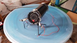 Underwater camera in its waterproof case, ready to be installed in a submerged marine cave © Octopus Foundation